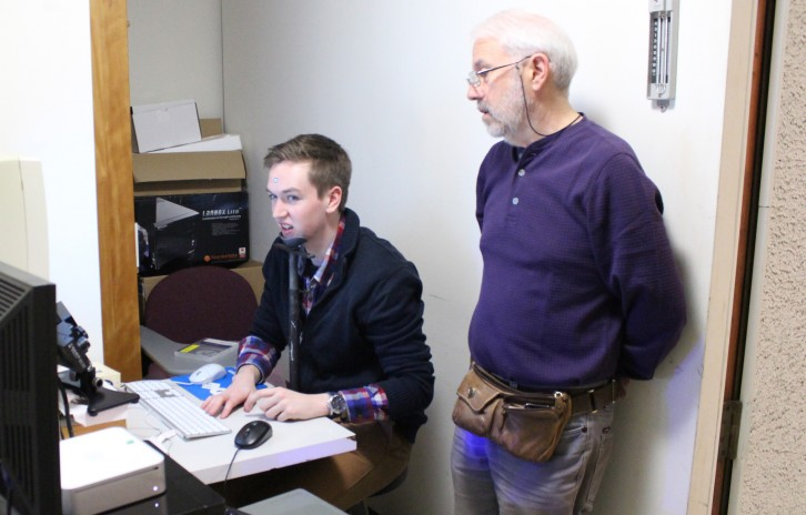 Klein and student Colin McCormick calibrate an eye-tracking system for an experiment.