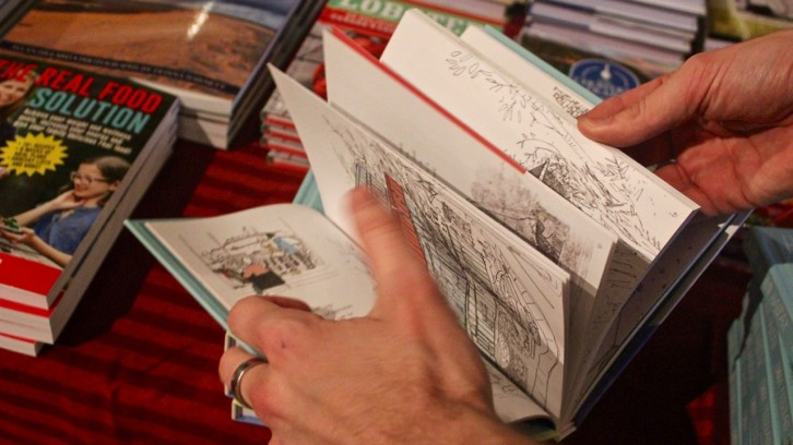 "Flipping through ""Hand Drawn Halifax"" (Formac Publishing Company Limited, 2015) by Emma FitzGerald. Photo: Rachael Kelly"