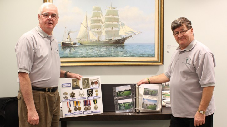 Volunteer Wayne Vacheresse and founder Vincent Joyce display a sample of the museum's artifacts
