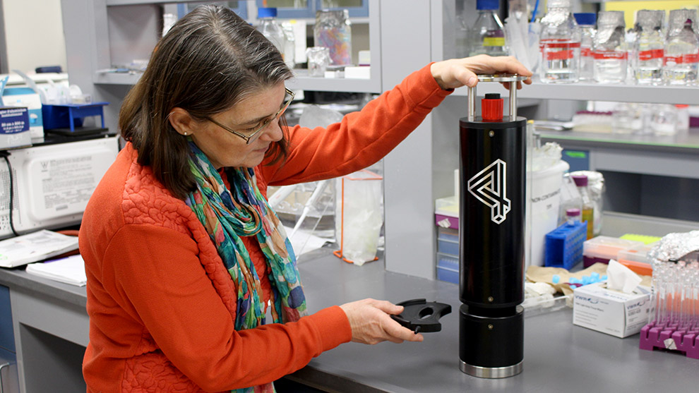 Julie LaRoche demonstrates the holographic microscope she will use in her upcoming plankton project.