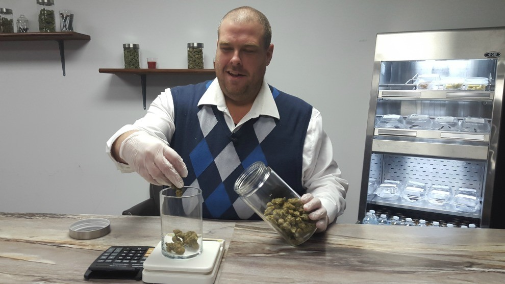 Mal Mcmeekin weighs marijuana the marijuana that will be sold to customers