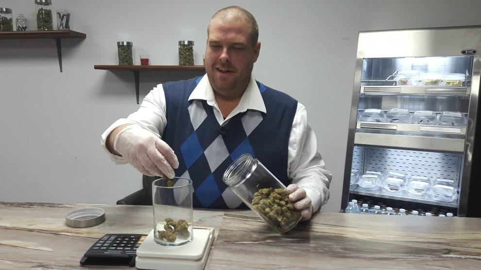 Mal Mcmeekin weighs marijuana the marijuana that will be sold to customers