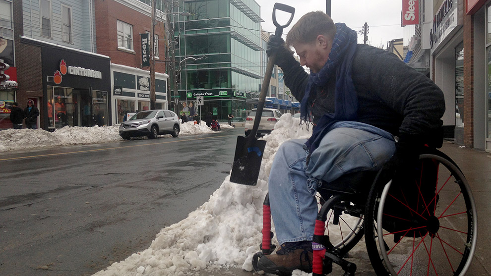 Paul Vienneau, 'Mayor of Spring Garden Road,' spent the afternoon clearing sidewalk corners and bus stops.