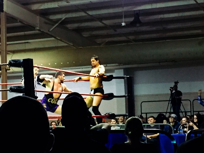 Colt Cabana, about to punch Richard Shinary in the… you guessed it.