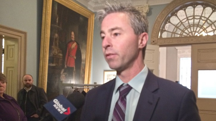 MLA Tim Houston answers media questions after committee meeting
