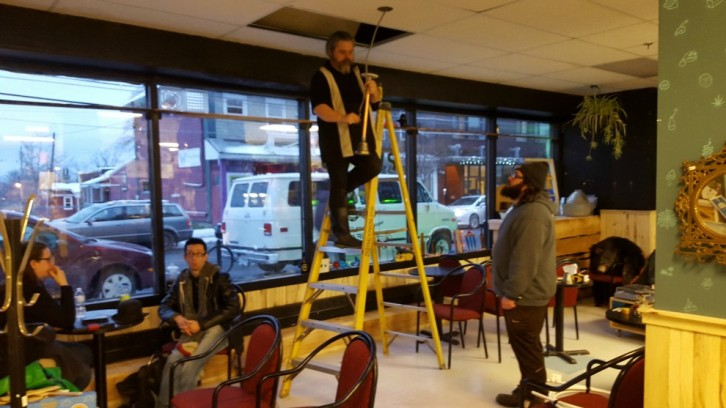 Bob Chiasson works on the new light fixtures at Plan B