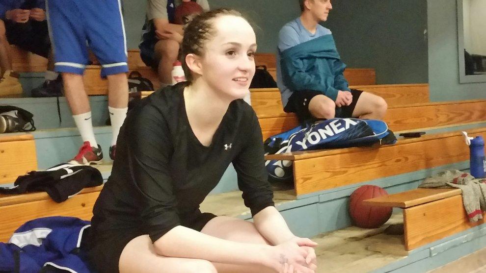 Maddie Alvarez watching teammates finish a match after practice