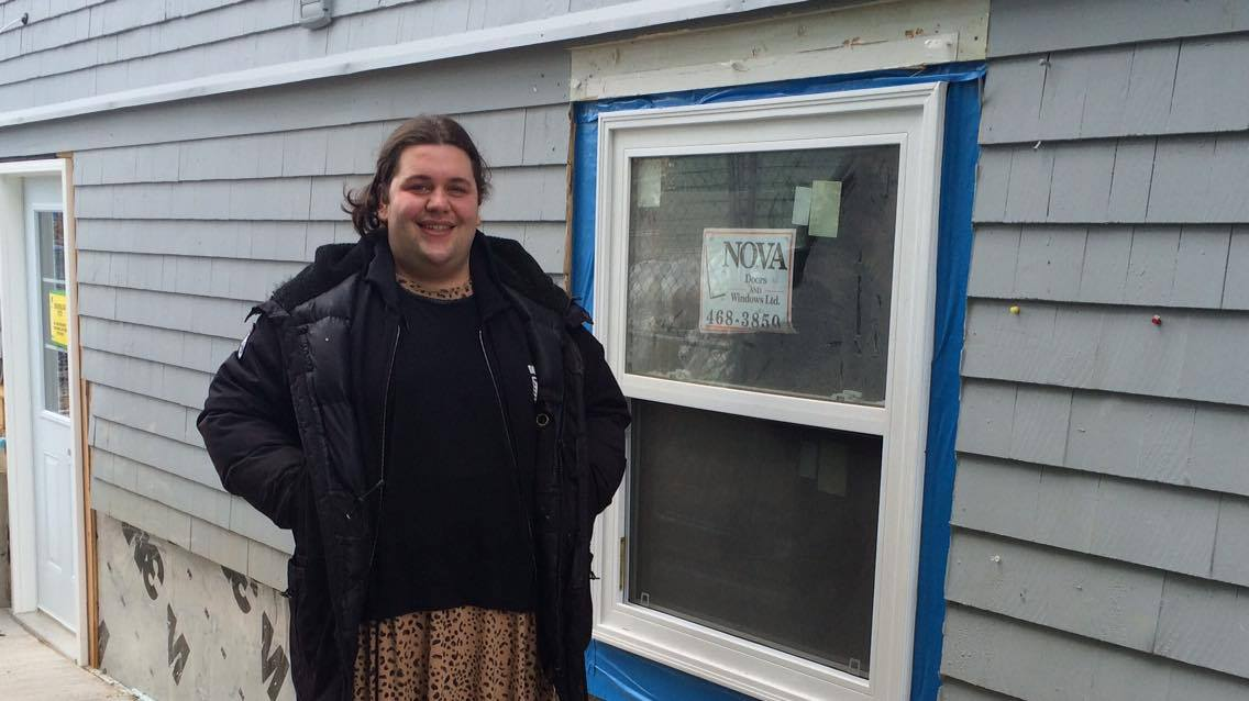 Rhiannon Makohoniuk stands in front of the old entrance of South House, which is currently undergoing renovations.