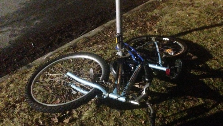 A bike is left attach to a signpost after being buried for the winter.