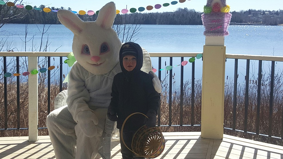 Adam, 3, poses with the Easter bunny.