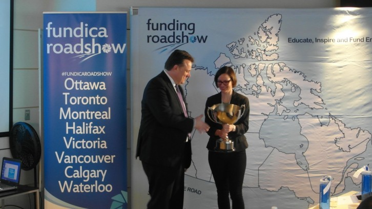Charlotte Rydland receives the Fundica trophy from Mayor Michael Savage