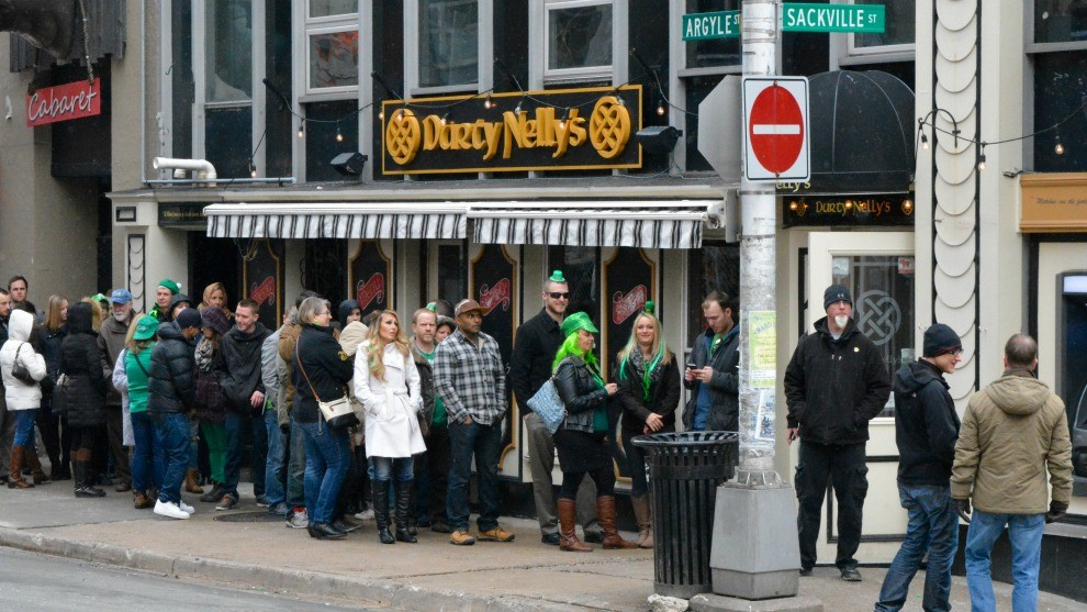 People waiting outside Durty Nelly's for holiday celebrations.
