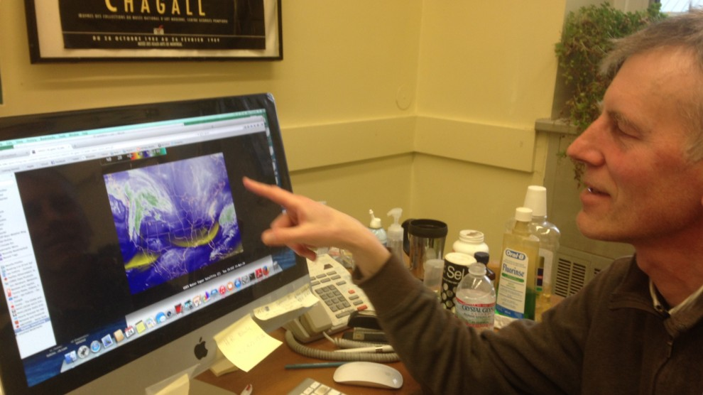 Ian Folkins shows a swirling storm on a weather model.