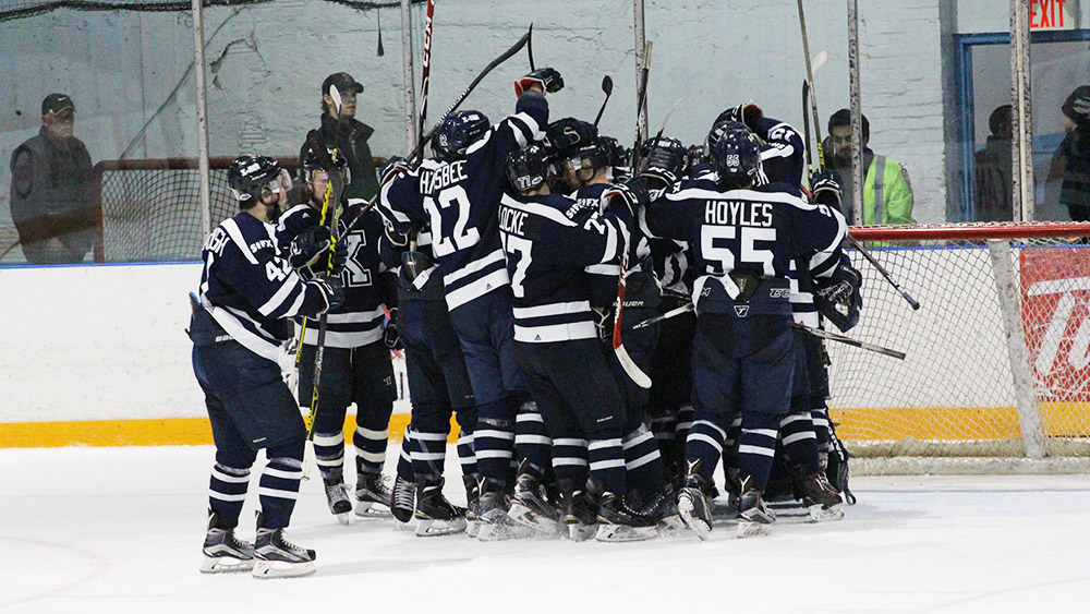St. FX X-men celebrate their 4-3 victory.