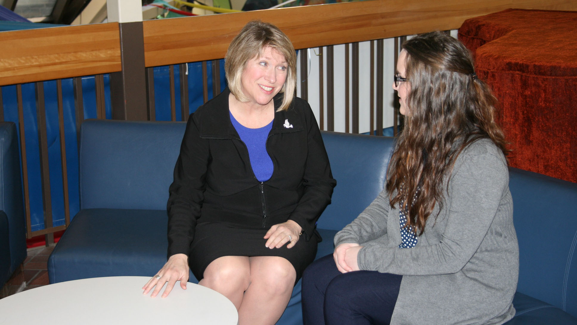 Minister Responsible for Youth Kelly Regan speaks with former summer student Jennifer West