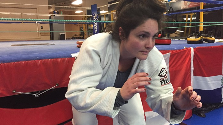 Sarah Murphy shows her jiu-jitsu moves at Titan's Fitness Academy.