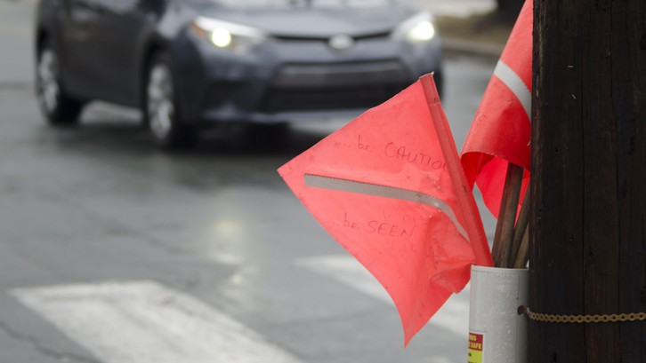 Safety flags ready for use at a crosswalk in HRM.