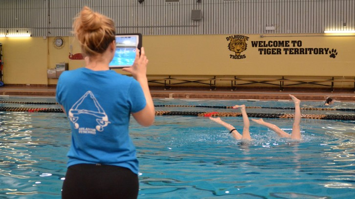 Ally Merrill uses an iPad to record video of her swimmers.