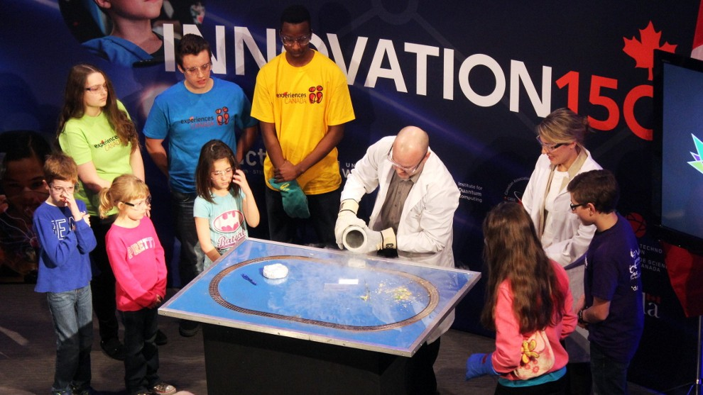 Martin Laforest, senior manager and scientific outreach at the Institute for Quantum Computing, does a quantum levitation demonstration for children.