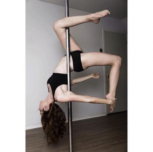 [Sangster posing on pole. Photo taken from Sangster's Instagram