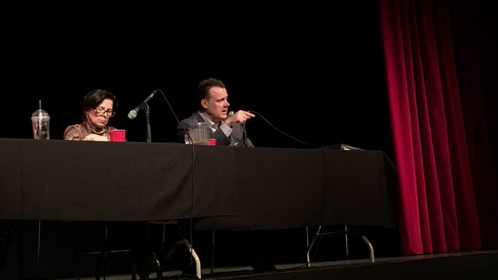 Halifax mayoral candidates Lil MacPherson and Mike Savage debate at Dalhousie University on Wednesday night.