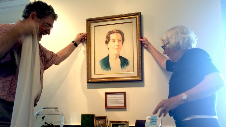Moore (left) and Scott unveil painting of Margaret Marshall Saunders