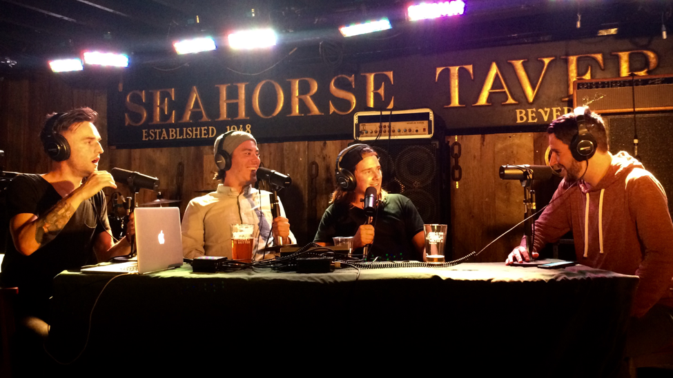 From left, Saunders, MacGillivray, and Stever interview MacDonald (far right) on live podcast.