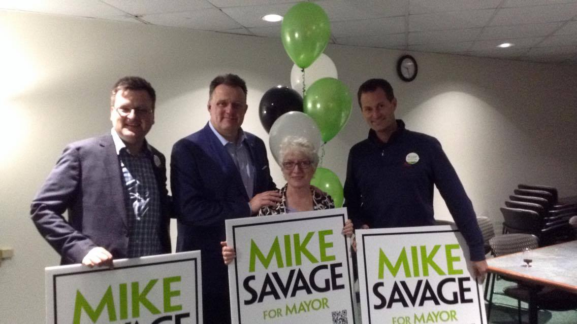 Newly re-elected Mayor Mike Savage celebrates with his campaign volunteers.