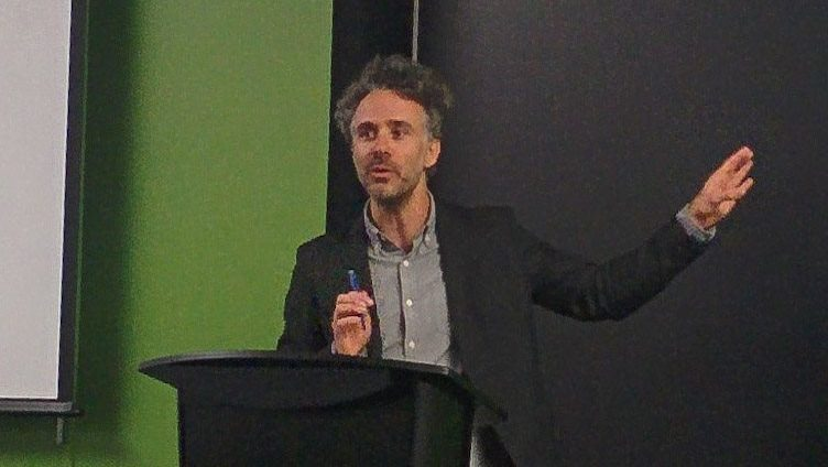 Dr. Ian Reilly spoke about the Yes Men's form of activism at the screening.