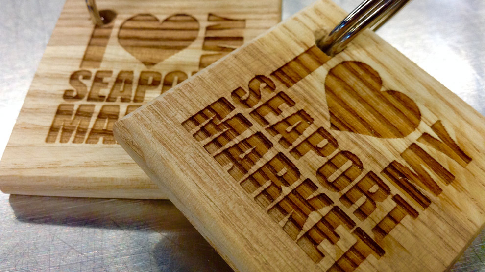 Keychains engraved into wood using laser technology at the Halifax Seaport Farmers' Market.