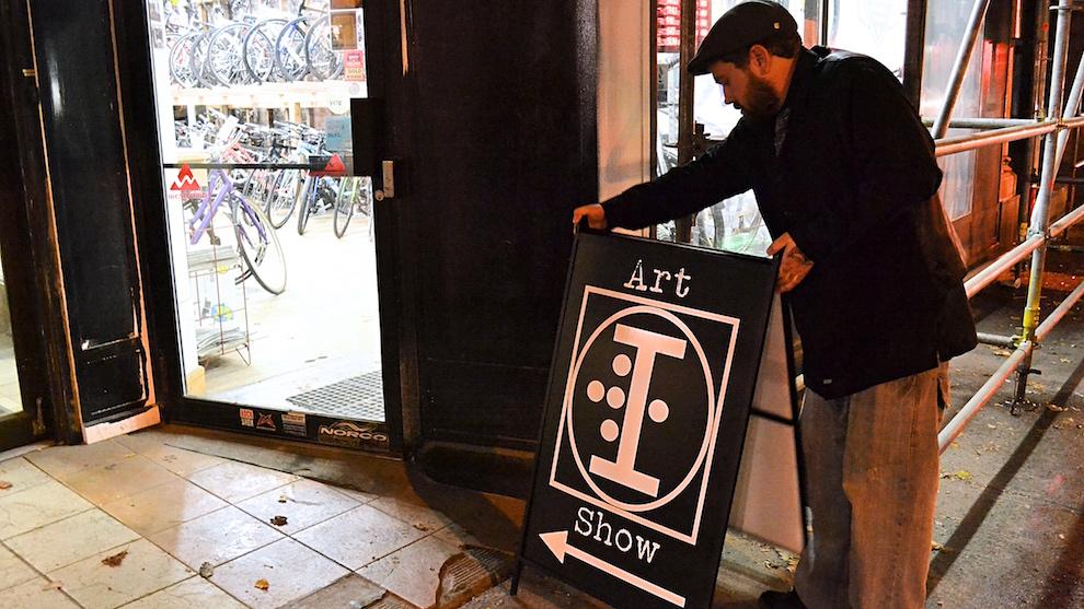 Organizer Gavin Quinn prepares for the Broken Deck Art Show outside of Elle's Bistro Friday Night.