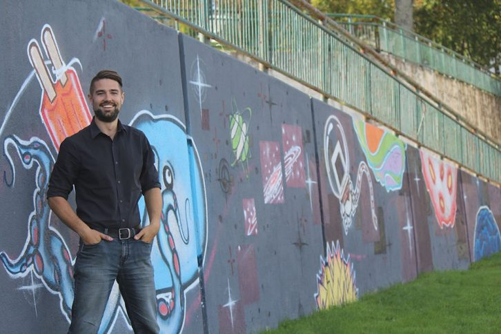 After talking with community members, Brenden Sommerhalder stands beside the Lovebot mural in Mulgrave Park - just a few streets down from where he lives.