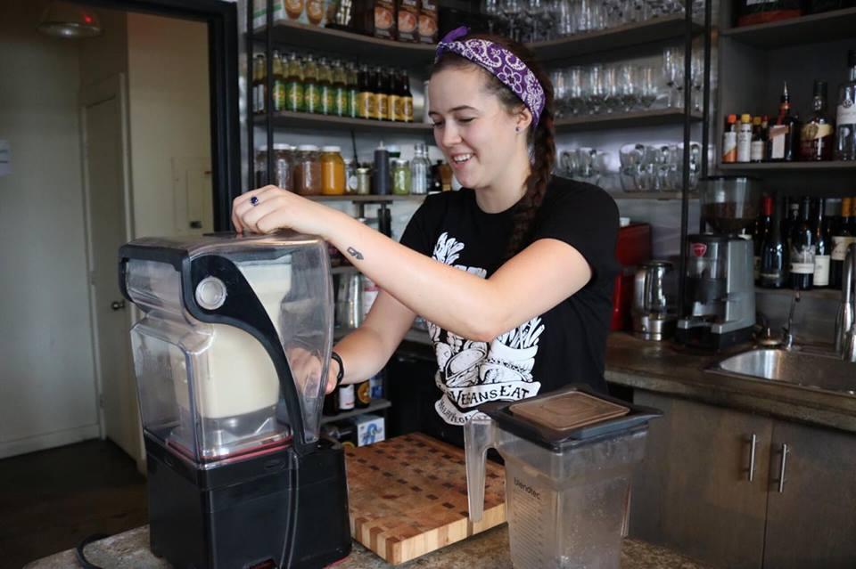 MacKenzie Hepditch, EnVie Vegan Kitchen cook, prepares cheesecake in a blender.