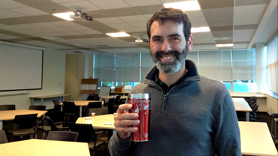 Fridell drinking coffee from his fair trade coffee mug after the seminar.