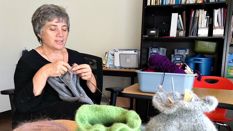 Linden Gray, founder of Caldy Grange knitting for the Philanthropic Knitters Guild - a project to end homelessness.