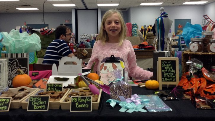 Madison Crawford stands at her table during the HRM Moms Fall Craft Market on Sunday