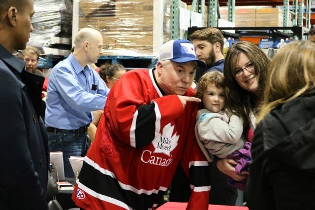 Canadian comic Mike Myers poses for photos with fans at Costco in Bayers Lake.