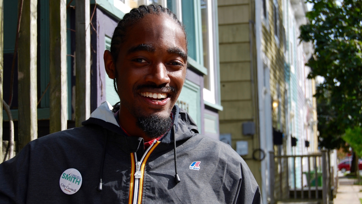 Lindell Smith canvassing door-to-door down Creighton Street, in North End Halifax.