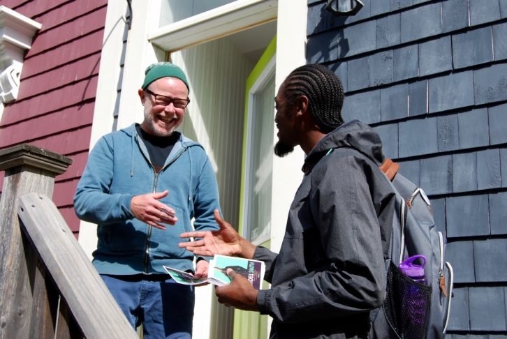 Smith introduces himself to James Cameron, a resident of the North End.