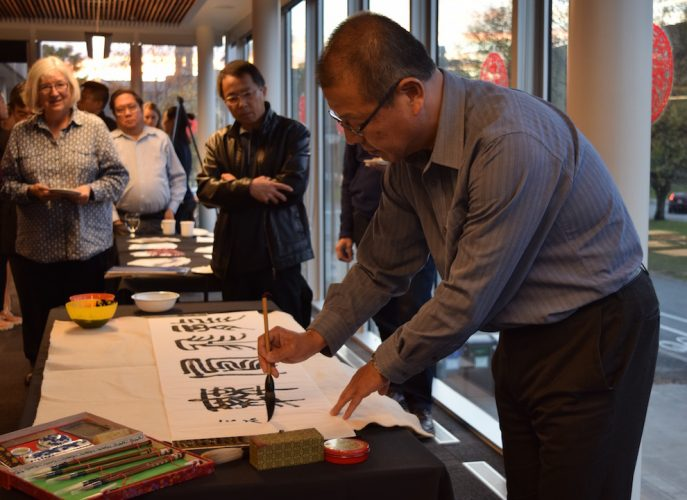 "During the demonstration, Dr. Lei Jiang wrote ""dragons flying, phoenixes dancing"" in the sitting, flying and walking calligraphy styles."
