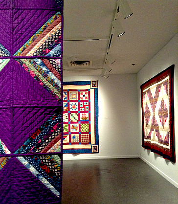 Three of the seven quilts at the exhibit in the Dalhousie Art Gallery.
