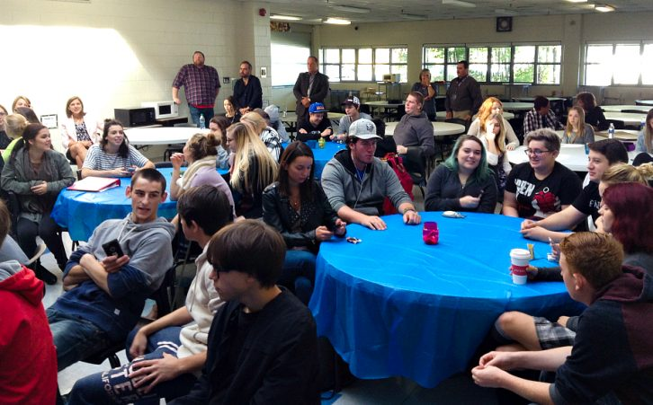 Students and visitors at Millwood High School gather to view the launch of the campaign.