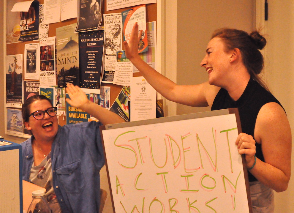 President of the King's Students' Union, Aidan McNally (right) celebrates what she calls a victory for the student movement Thursday.
