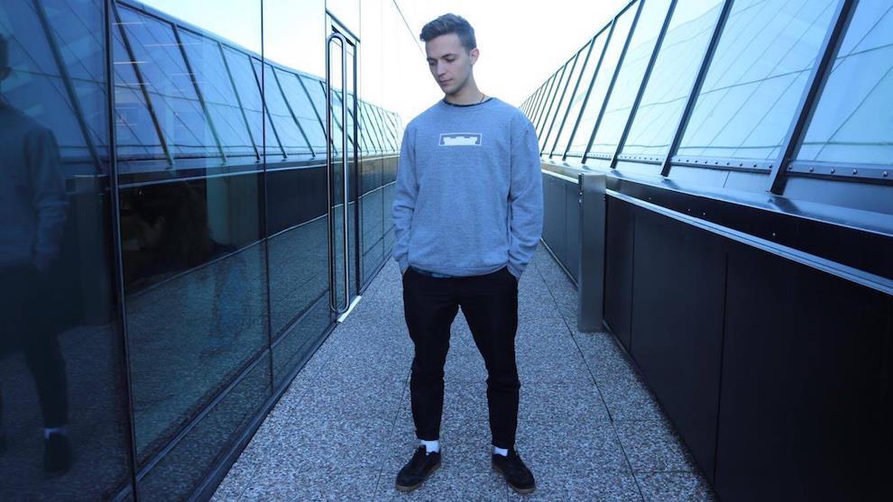 Co-founder of Citadel Clothing Co., Josh McKenna models their grey crewneck.