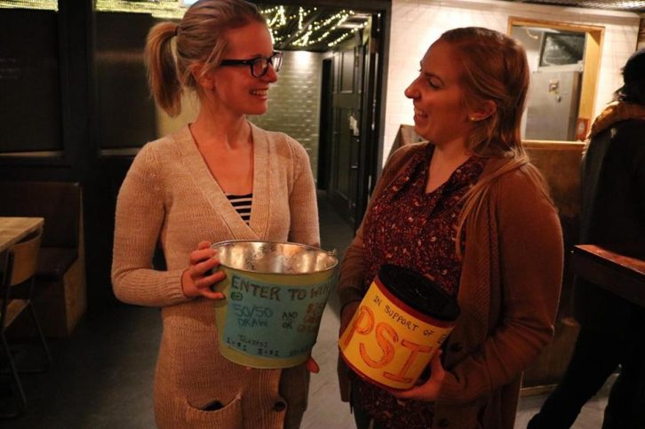 Meagan McPherson and Krystyna Brown hold a raffle to raise money for P.S.I.