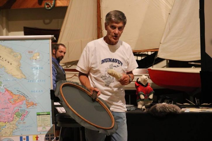 Newbery shows the audience an Inuit drum made of Labrador cloth.