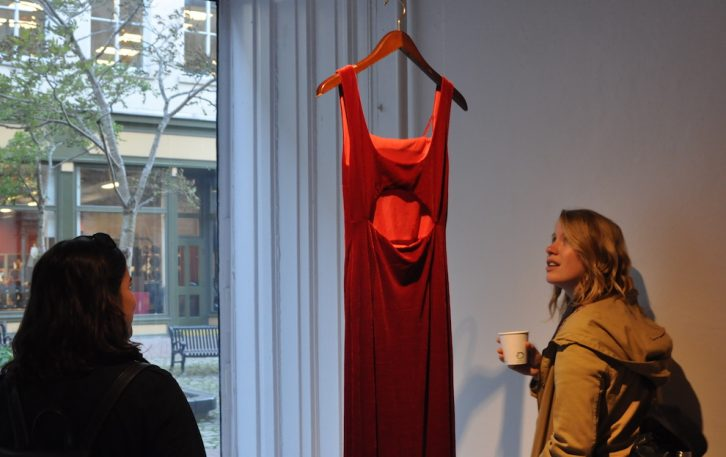 Rachel Berman (left) and Maddie Johnson viewing the REDRESS Project opening at Anna Leonowens Gallery in Halifax.