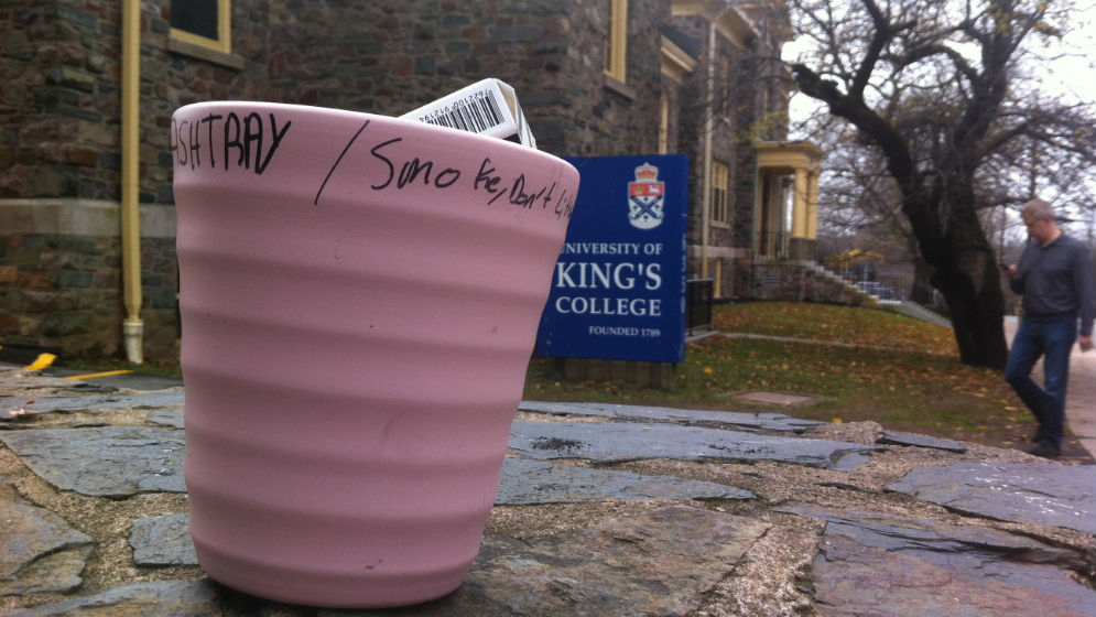 Banned from smoking on campus, smokers use this makeshift ashtray during cigarette breaks.