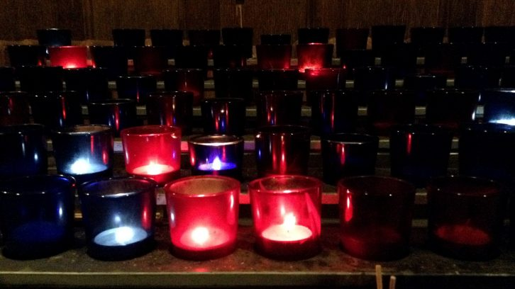 Prayer candles burn brightly in St. Mary's Cathedral Basilica.