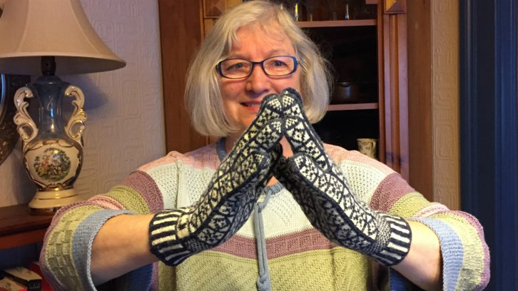 Corrie Watt shows a pair of Sanquhar gloves, which she knitted upon a pattern Neatby brought 20 years ago.